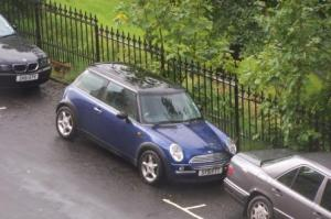 View of A Cute Little Mini Cooper From The Apartment Window