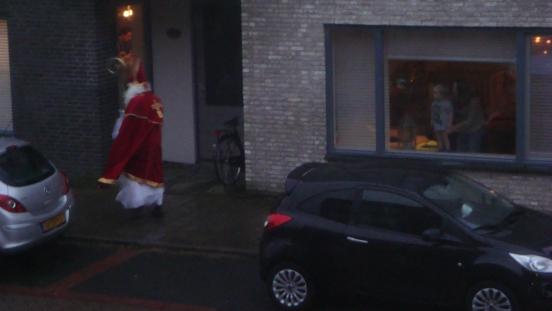 Check out our neighbor's kid in the window watching Sinterklaas! Priceless!