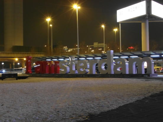 Schipol Airport's famous 'I amsterdam' sign at night in the snow.